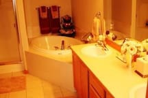 Off the master bedroom is the master bathroom.  2 sink vanity, tub, shower & private toilet.