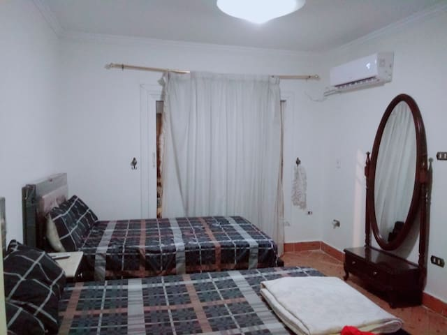2nd bedroom with two single beds, large clothes cabinet in dressing room and new air conditioner