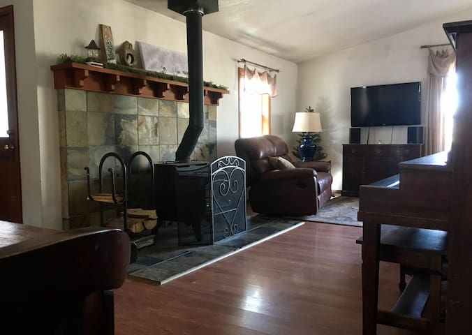Open concept from dining into living room area, and wood stove