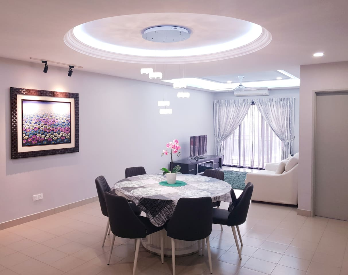 Cosy interior design with basic furnitures for living and dining areas.