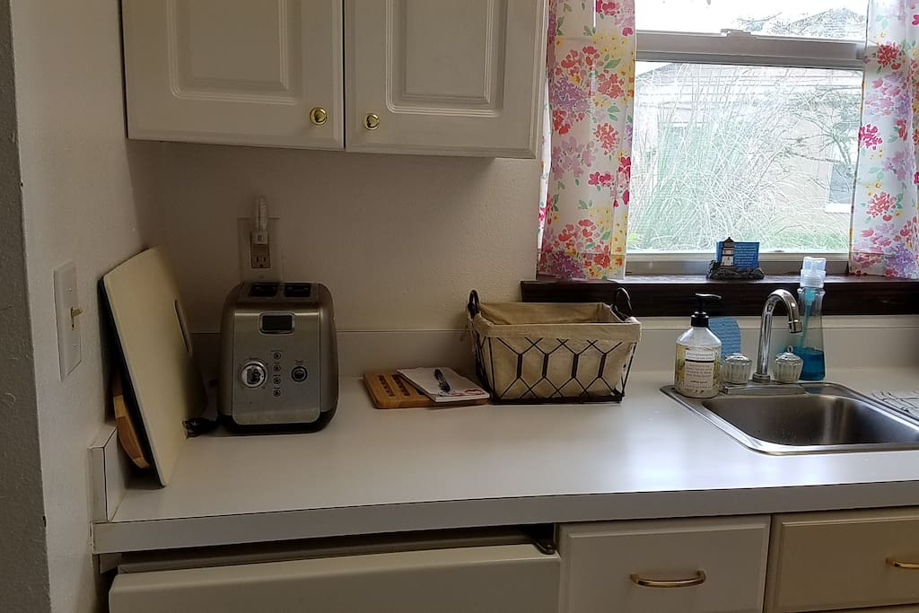 Toaster, Microwave, Oven, Stove, Sink, Coffee Maker with Coffee, Cream, Sugar