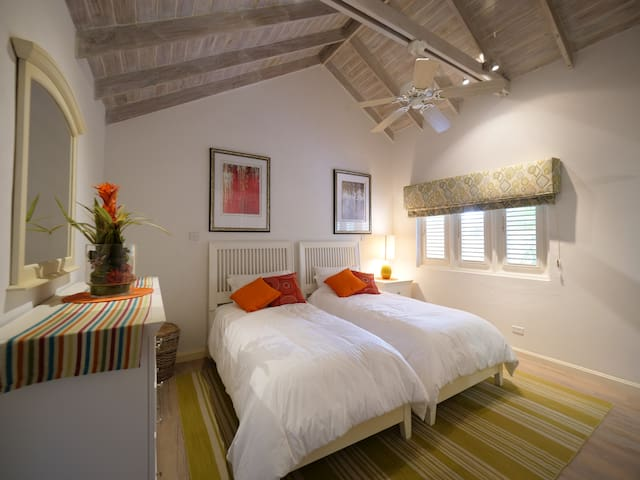 Air conditioned guest bedroom #2 with twin beds and ensuite bathroom.