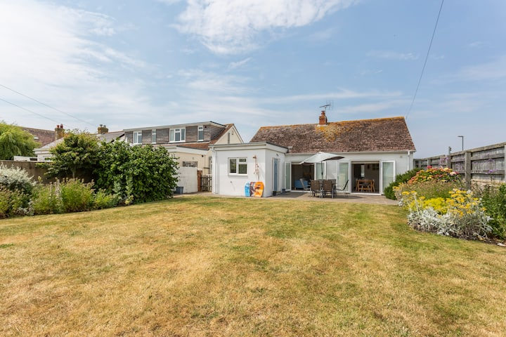 Lovely family cottage just metres from the beach