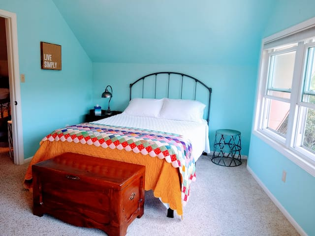 The peaceful, sunny, UPSTAIRS BEDROOM, has a great view of the hills and sunrise. Queen bed with memory foam topper.