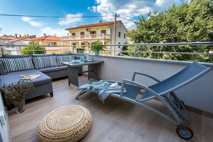 Specious Terrace equipped with comfortable lounge armchairs and table.