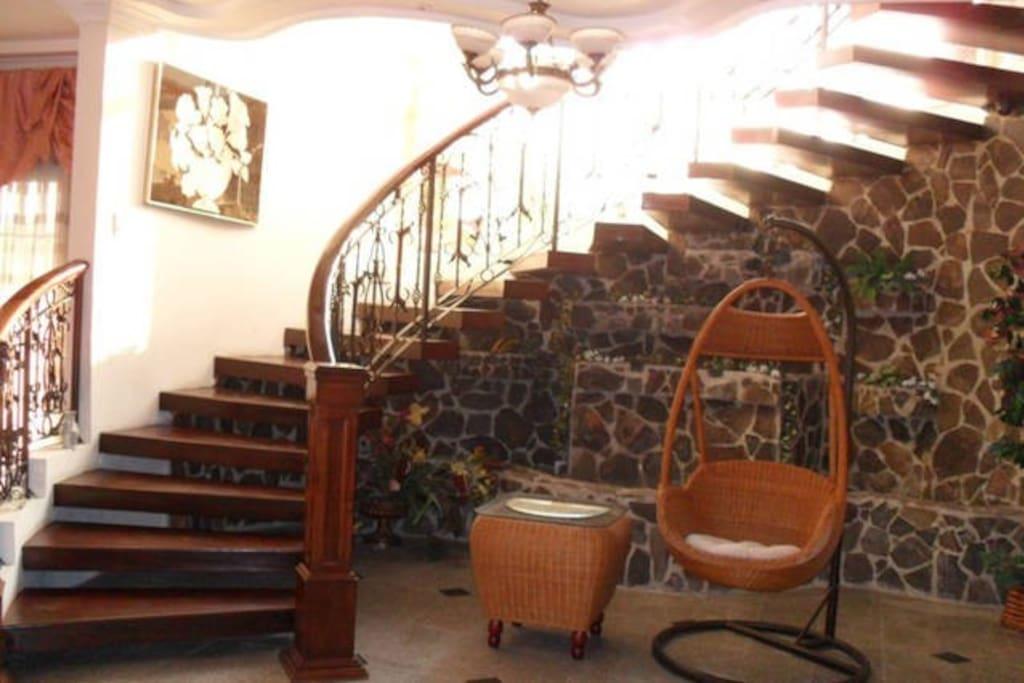 Interior spiral stairs case to second floor
