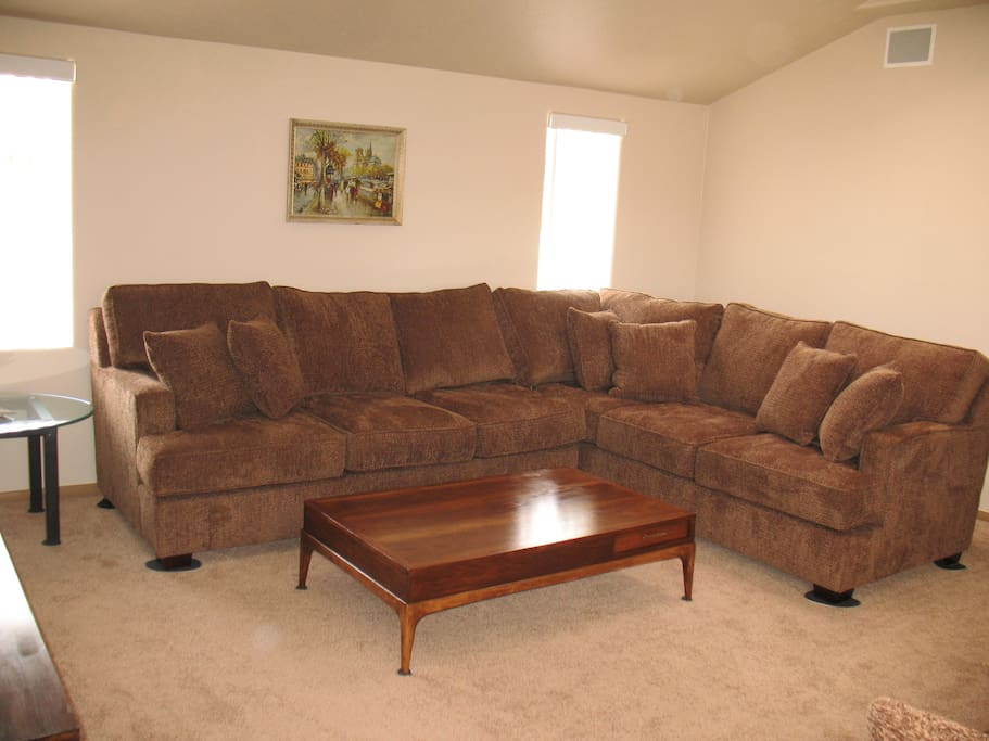 Over sized sectional in den.