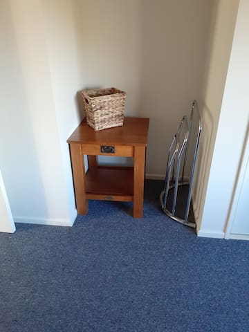 Bedroom 2: little alcove for towels rubbish bin and  resting table