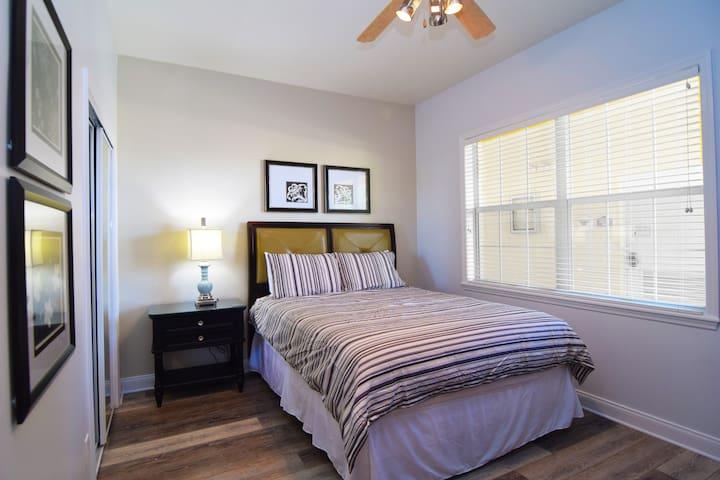 Beautiful queen bedroom with flat screen TV