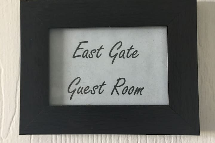 "Your door is labeled with this sign - ""East Gate Guest Room"""