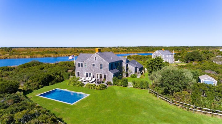Luxury home with pool, water views & walk to beach