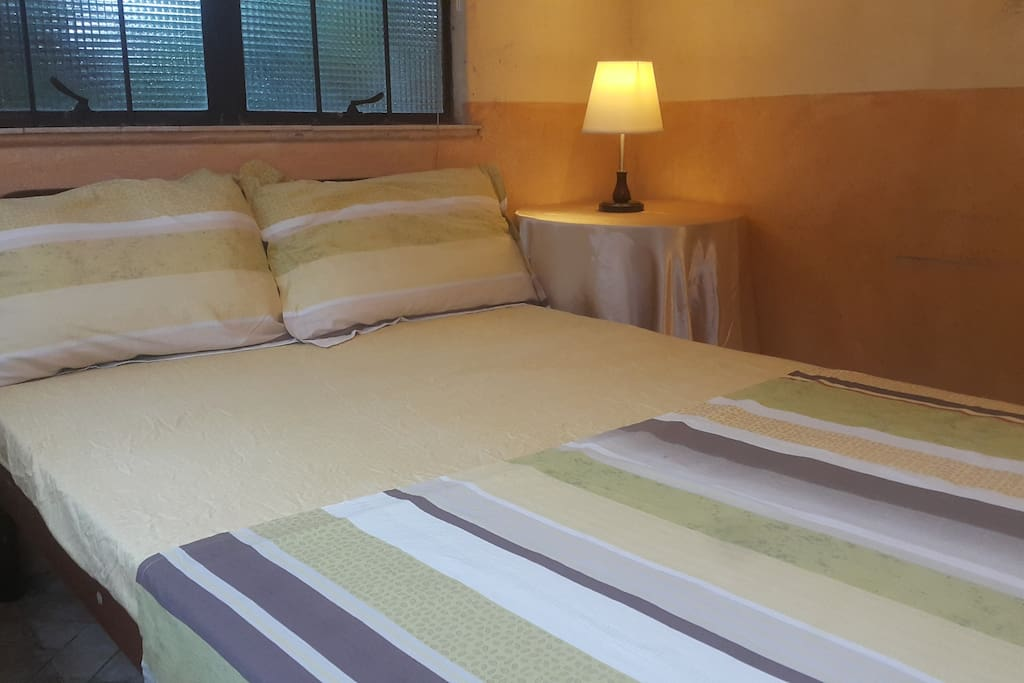 DOUBLE BED, AIR CONDITIONED, CABLE TV IN 2 BEDROOM GUEST HOUSE WITH KITCHEN, SALA, & DINING TERRACE