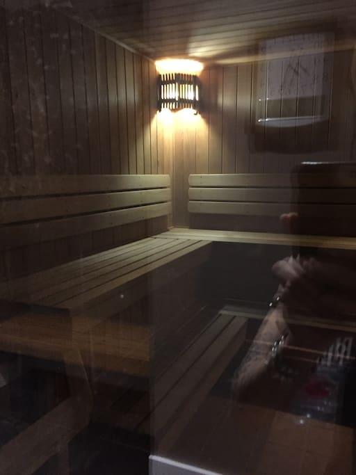Cedar sauna room same opening hours as pool