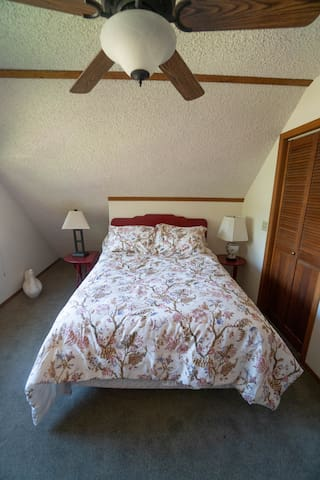 The sunset room has a full bed with ample closet space to store luggage and souvenirs.