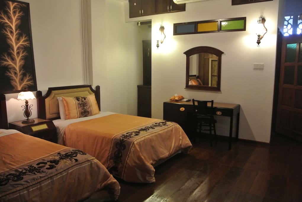 furnish with 2 super single beds,air-cond,ceiling fan,t.v with  international channel,minibar fridge,total build up space 234.64 sq.ft/2.03 sq.m attached with toilet.
