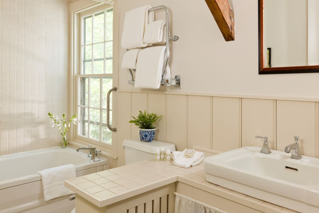 Spa tub for two and heated towel bar.