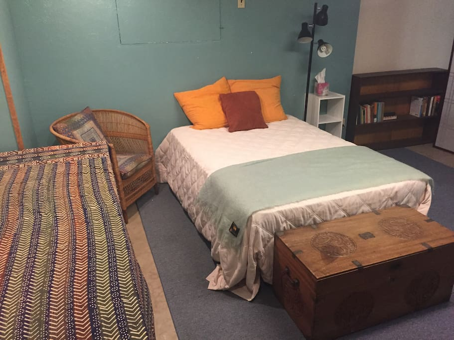 Double bed with down comforter.