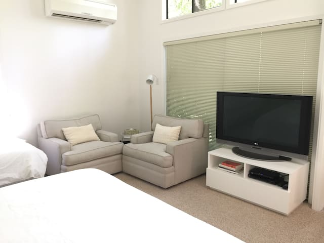 Small sitting area and television with basic cable and DVD player.