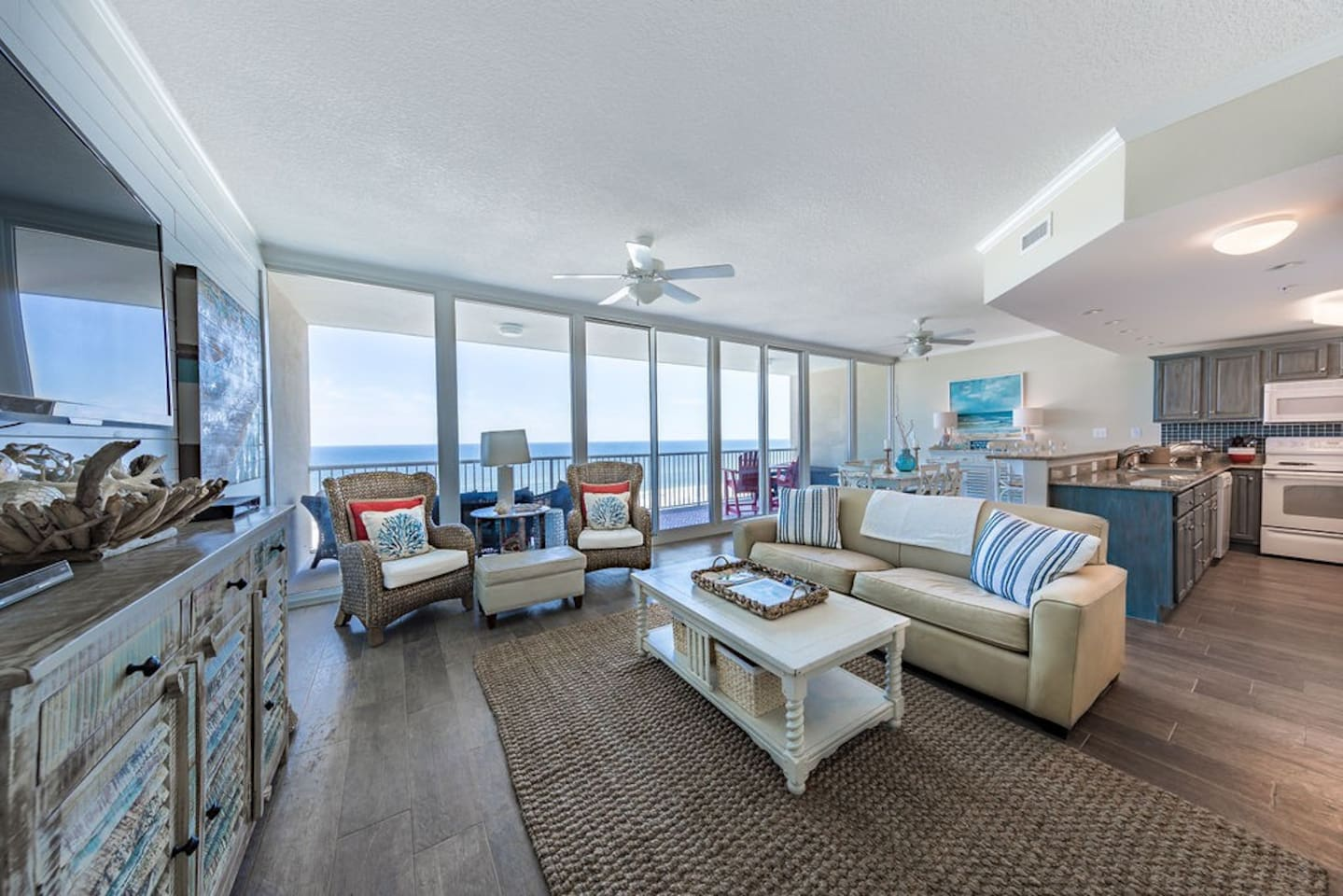 large open floor plan with 30 feet of window views of the ocean.  Welcoming decor for you to relax and a large balcony with seating to relax with your favorite beverage and enjoy miles and miles of ocean views.  Perfect views at sunrise and sunset.
