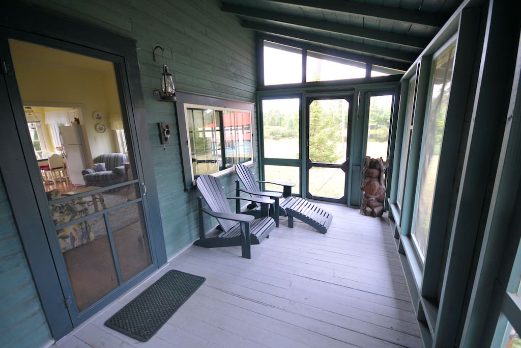Screened in porch over looking Carpenter Pond.