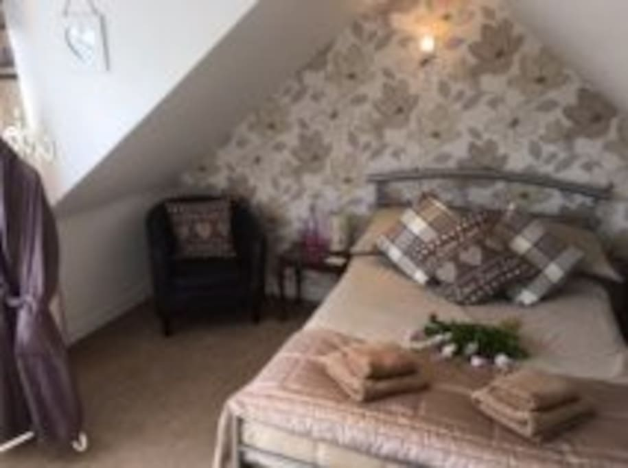Double attic room (shares a bathroom with twin room). Can fit a sofa bed