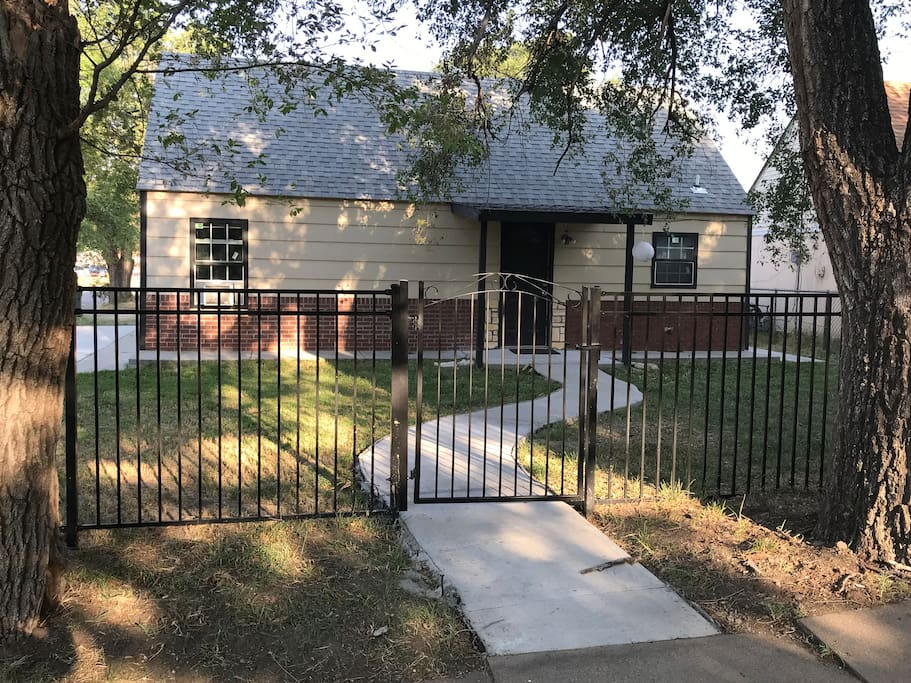 Front entrance with fence for a private atmosphere. you can park on Topeka st. and go thru the gate if you want, or you can park in our Aibnb private parking behind the house