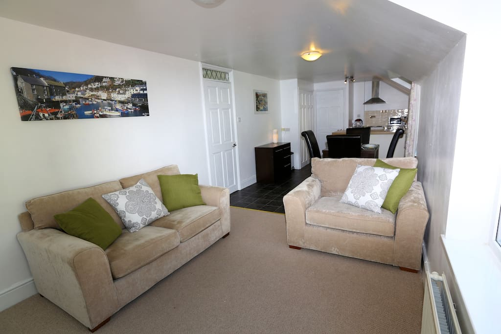 Lounge room leading to open plan dining area and kitchen at the rear.
