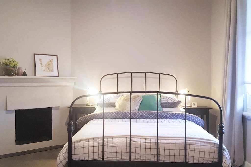 The second spacious bedroom has a double bed, ornamental fireplace, hanging space, privacy blind and generous block out drapes.