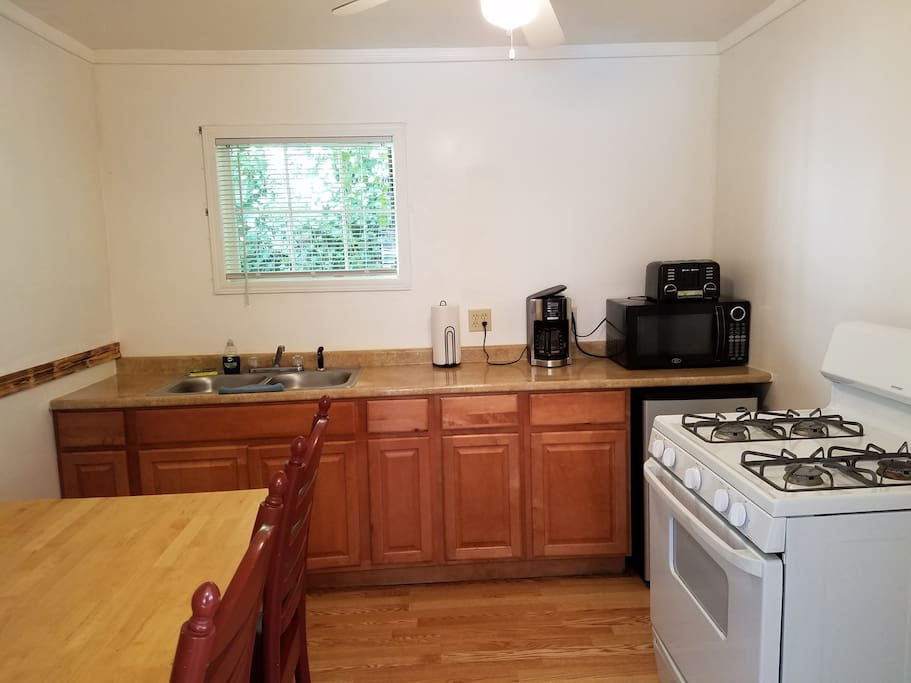 Full kitchen including stove and oven. All utensils, plates, etc. provided.