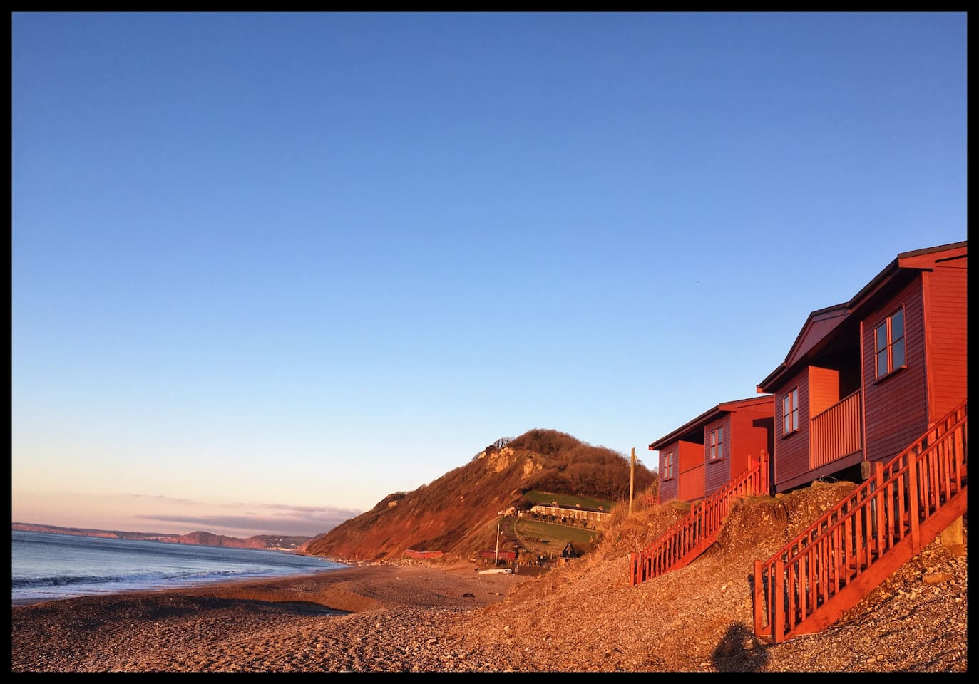 Swift and Curlew Chalet, side by side in the sunset