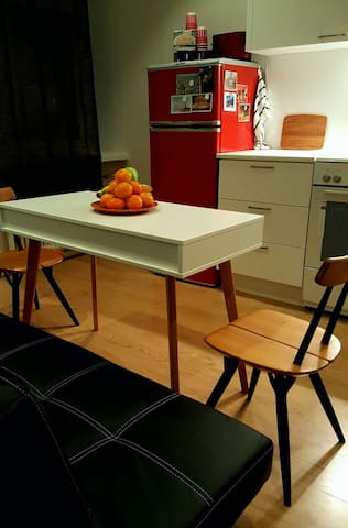 The kitchen is where it all happens! Cool & slick Scandinavian design and even a table perfect for those office hours