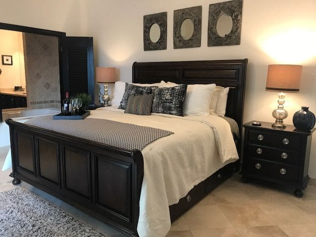 The master bedroom offers a jacuzzi tub that separates the bedroom from the bathroom.  Need privacy?  The shutters allow you the close off the bathroom.
