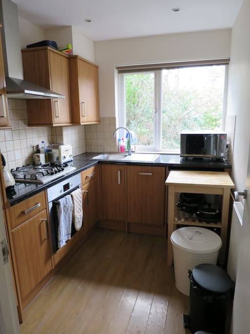 Fully equipped kitchen with 4 ring gas hob a & electric oven, floor to ceiling fridge/freezer, microwave, slimline dishwasher and combined washer/dryer.