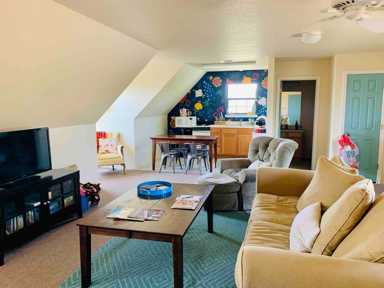 Living area and kitchenette. This studio apartment is 700 square feet and is just right for a cozy stay for couples or small families.