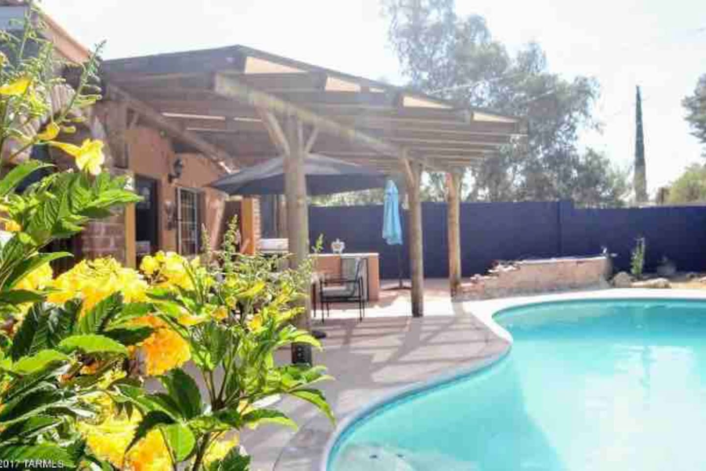 Private pool with covered ramada, BBQ, outdoor fridge, and even a putting green! Perfect for relaxing in private.
