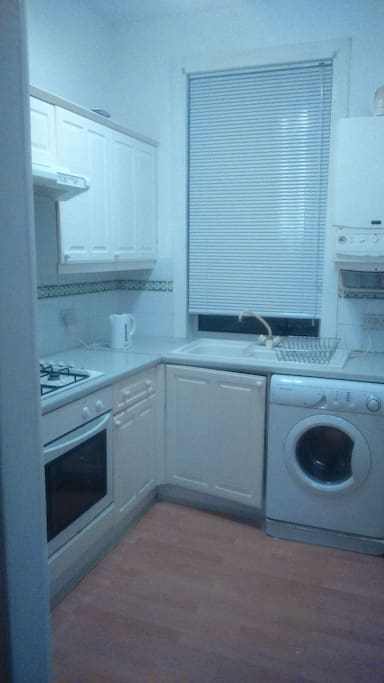 Fully equipped kitchen with patio/garden access