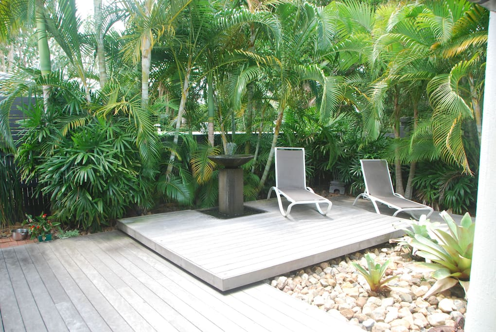 Soak up the sun on the deck chairs overlooking pool.