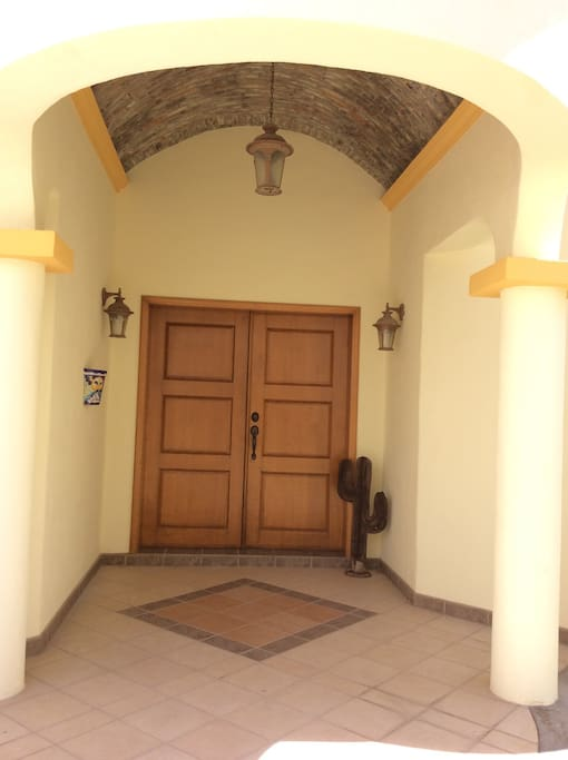 Entry to Villa #4.  New appliances, washer and dryer, air conditioner unit, ceiling fans, paint, decor and furnishings.