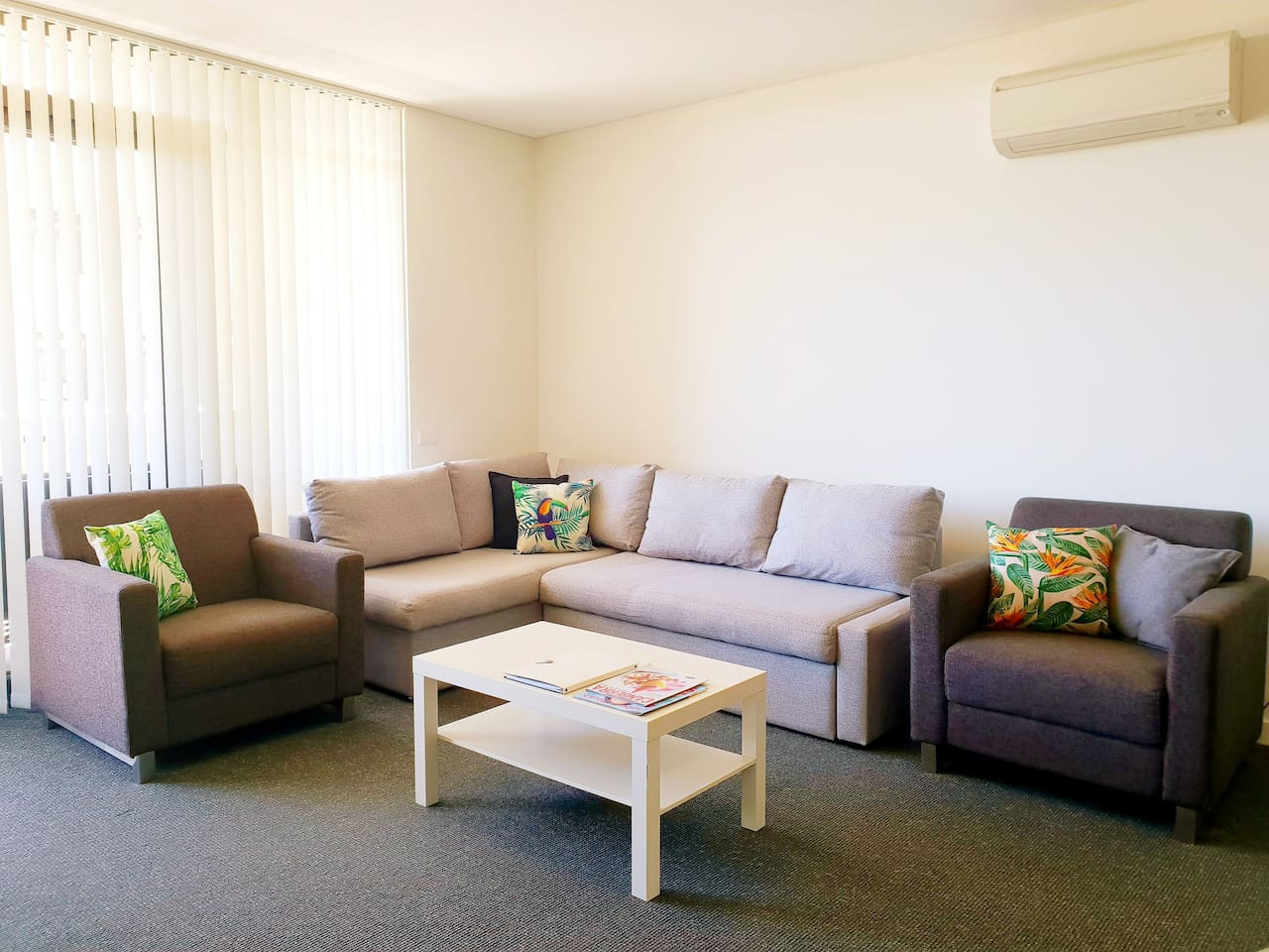 Spacious lounge room with plenty of seating. The corner lounge suite pulls out into a double bed for additional guests. Pillows and linen are supplied if the sofabed is requested.