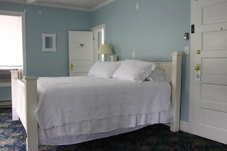 """Cozy sleeping for 2 in the """"Blue"""" room of this Historic Country Inn. This room is one of 7 private rooms with a private bath in each room.  The pastel-hued rooms outfitted with delicate quilts have a vintage vibe. Continental breakfast included with your stay."""