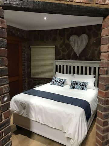 Queen-size bed in bedroom