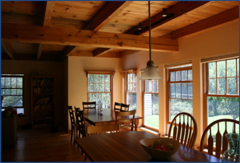 The honey colored dining room