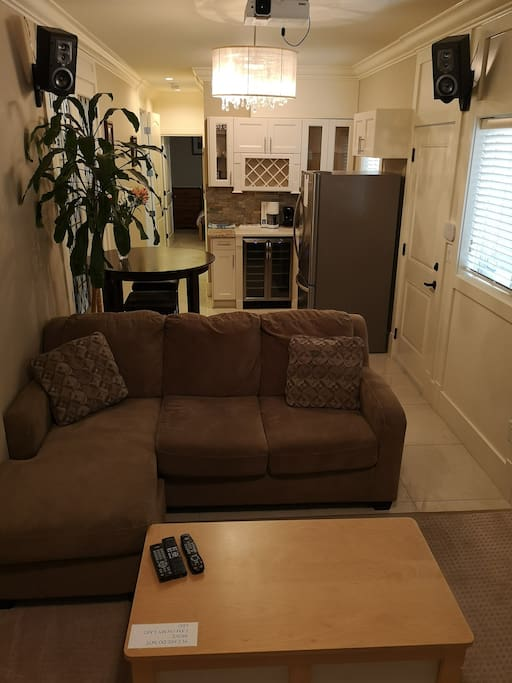 Small kitchen & eating area, sectional sofa, & seperate side entrance.