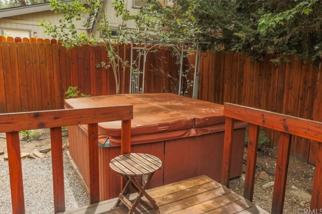 Back deck and spa. Completely fenced in making it a great space for small pets!