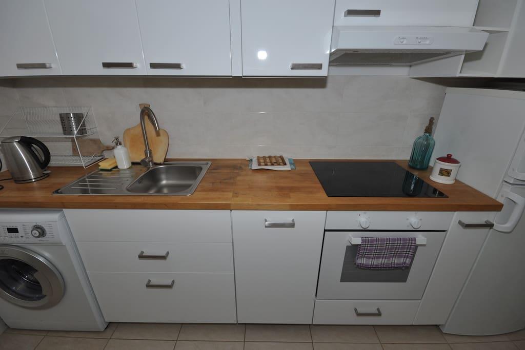 washin machine, dishwasher, induction hob, oven, fridge