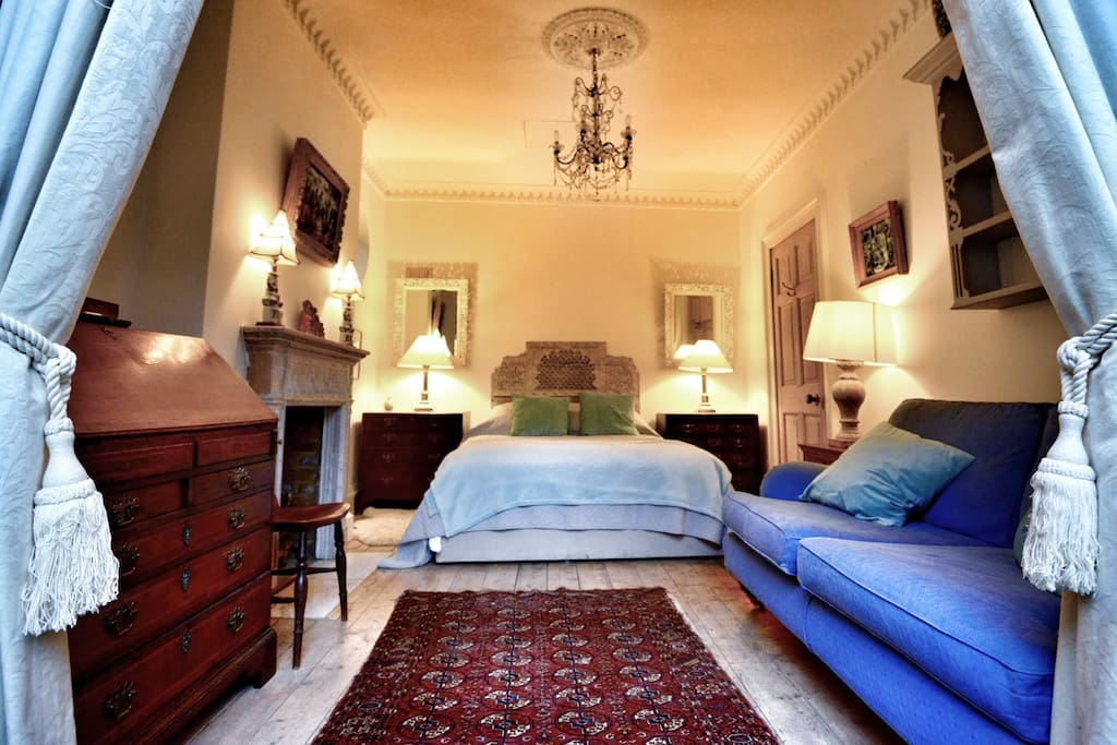 The bedroom has been furnished with beautiful antique furniture.