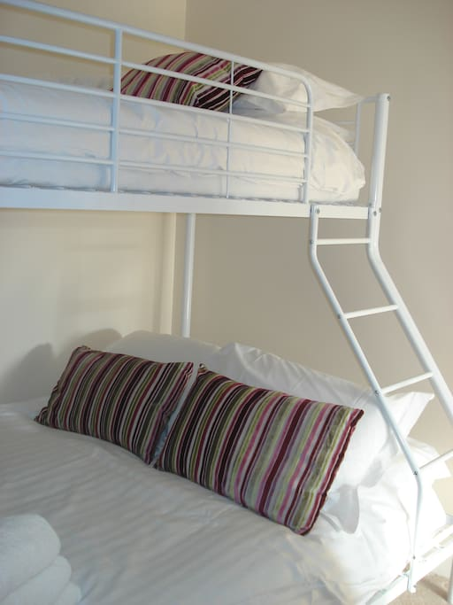 Triple full sized bunk beds for three in the 2nd bedroom