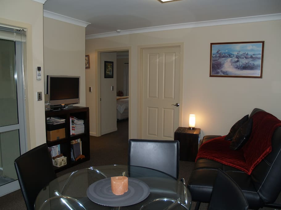 Small lounge area has a sofabed & TV