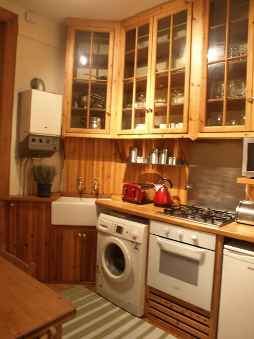 Fully equipped kitchen with Belfast sink and breakfast table