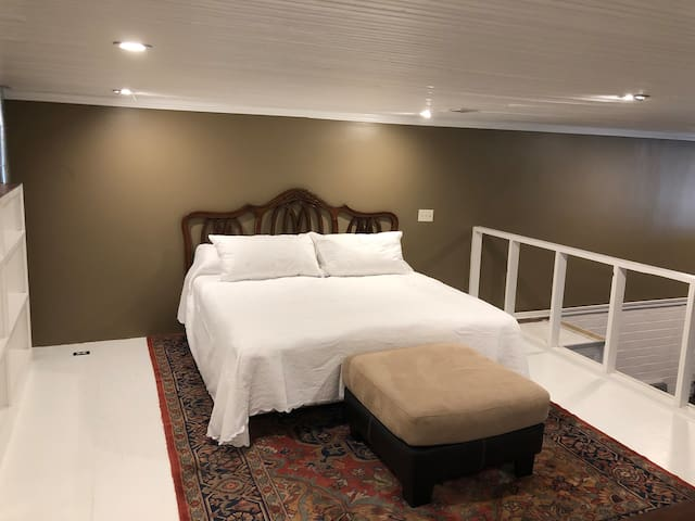 Sleeping Loft with King size bed, and Tv.